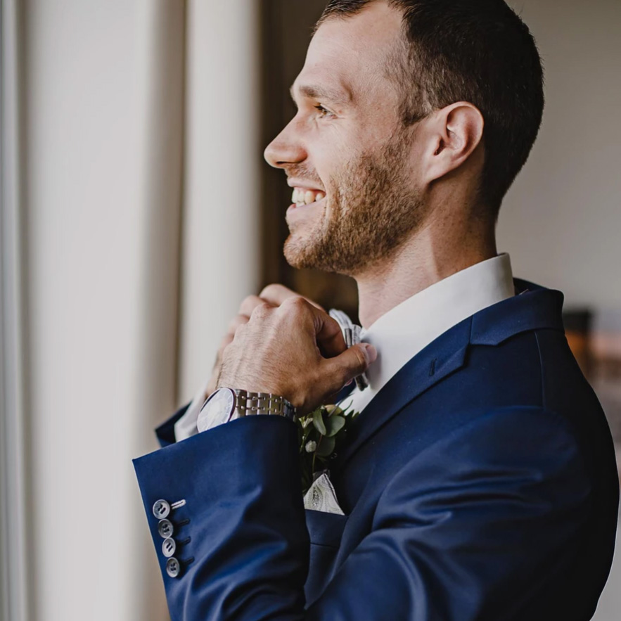 groom-getting-ready-for-wedding-picture-by-wedding-photographer