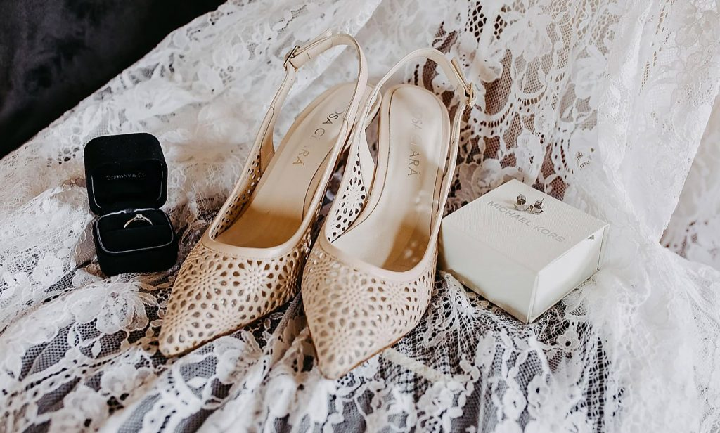 wedding-ring-shoes-on-wedding-dress